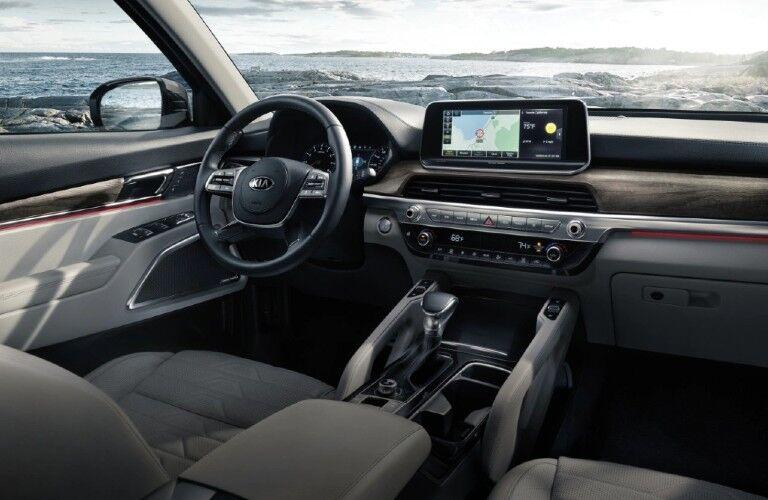 Steering wheel, gauges, and touchscreen in 2021 Kia Telluride