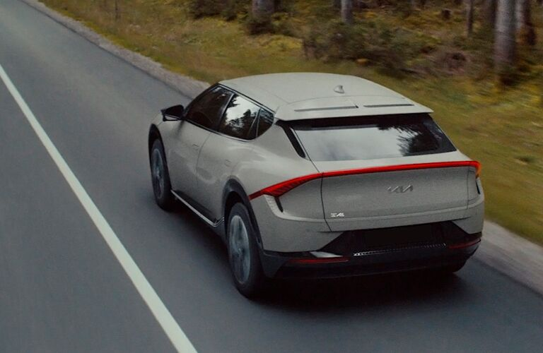 2022 Kia EV6 exterior rear fascia driver side on blurred road