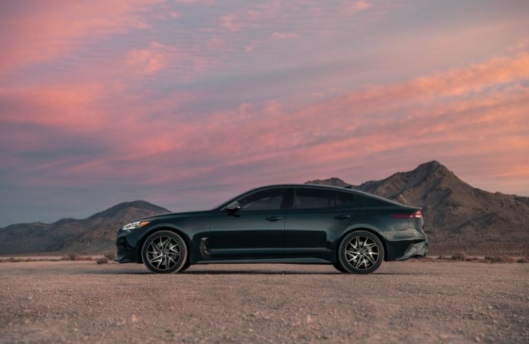 2022 Kia Stinger exterior driver side profile with sunset