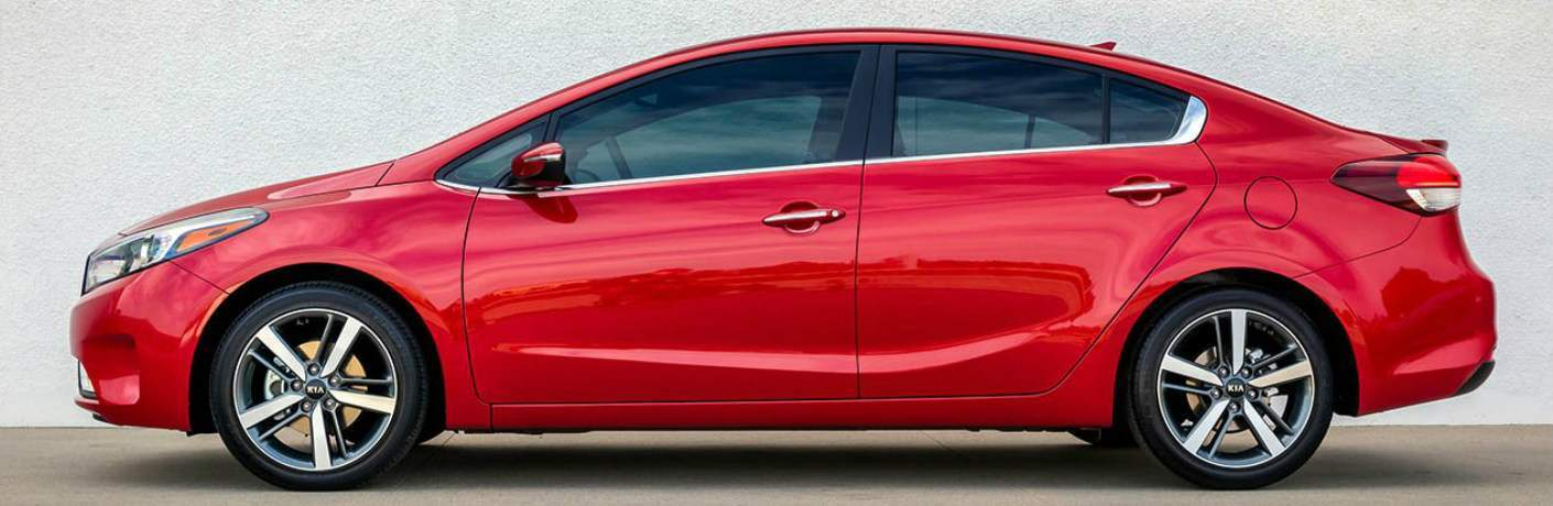 Red 2018 Kia Forte Parked next to a White Wall