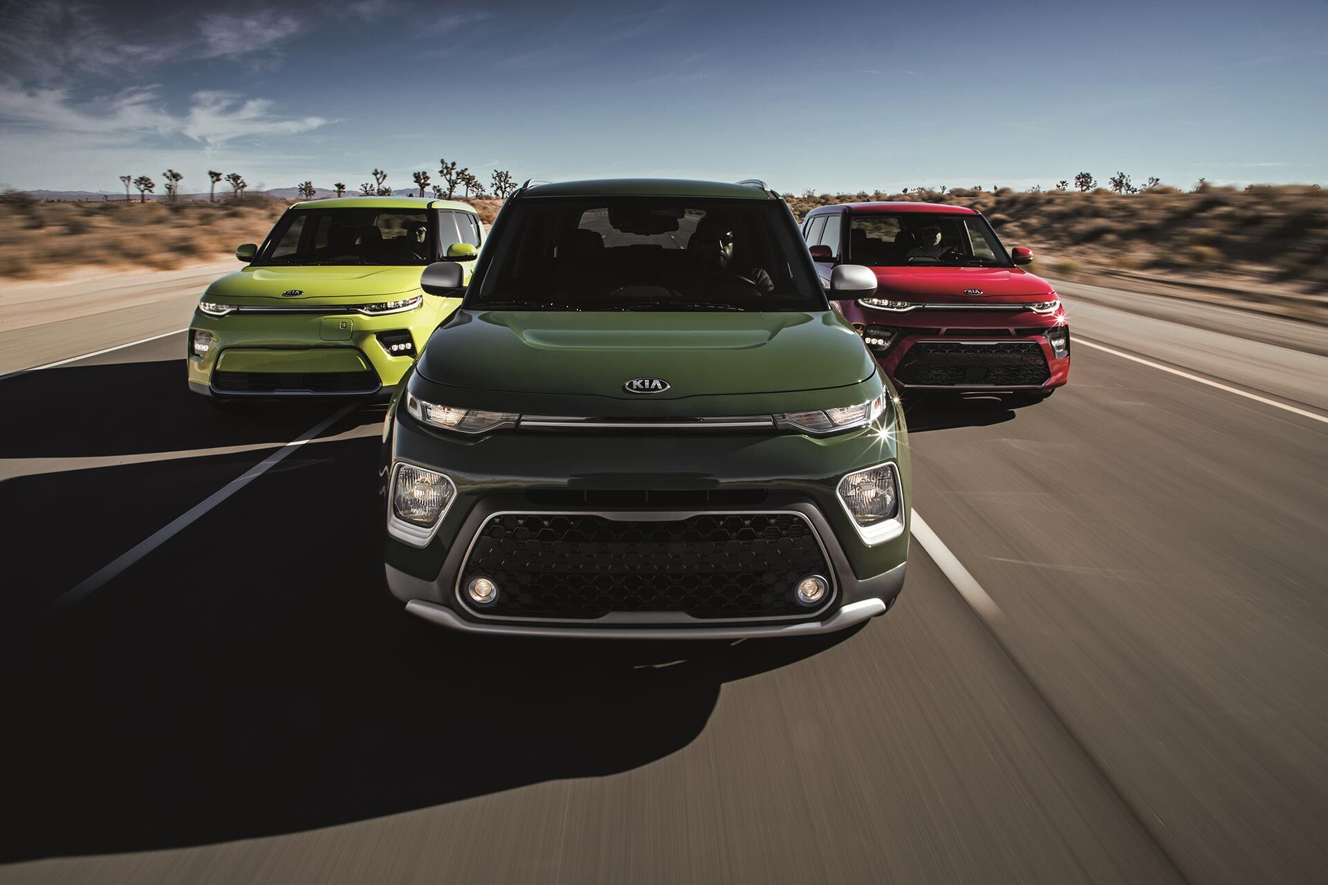 Three 2020 Kia Soul driving down the highway