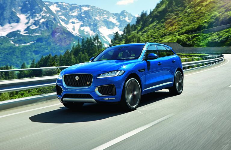blue 2017 Jaguar F-PACE on a mountain road
