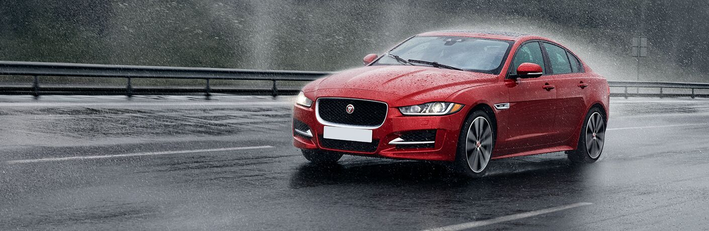 front view of the 2017 Jaguar XE 20d driving in the rain