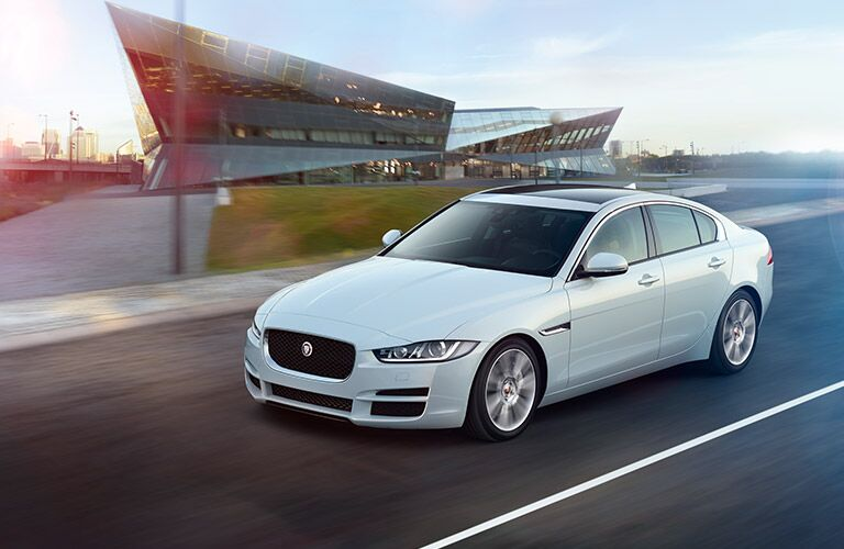 white 2017 Jaguar XE on the road