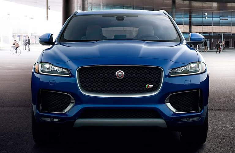 front grille close-up of a blue 2018 Jaguar F-PACE in a warehouse