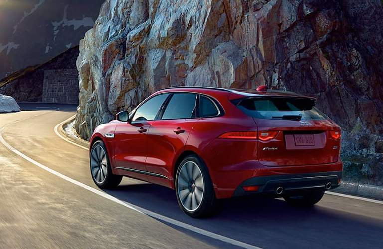 rear view of a red 2018 Jaguar F-PACE on a mountain