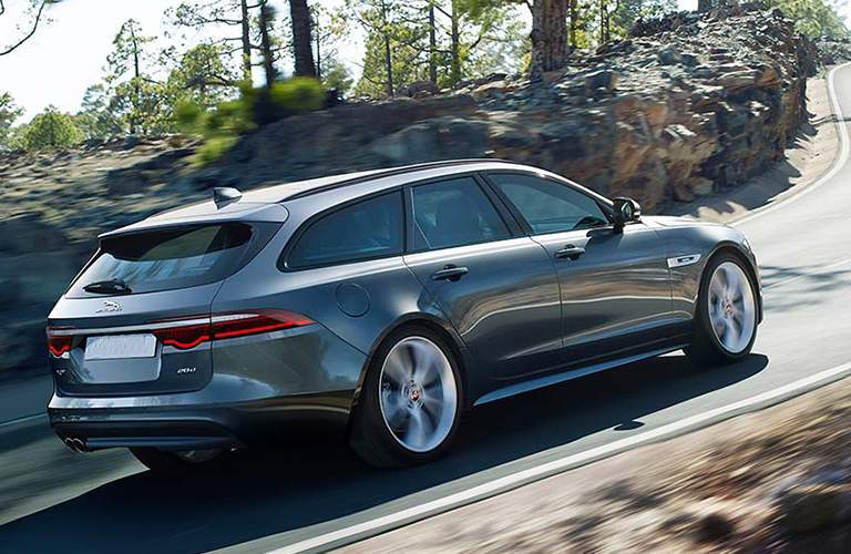 side and rear view of the 2018 Jaguar XF Sportbrake going up a steep road