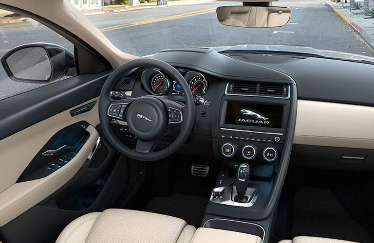 steering wheel and infotainment of the 2018 Jaguar F-PACE