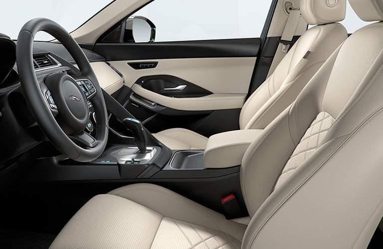 white front seats and steering wheel of the 2018 Jaguar E-PACE