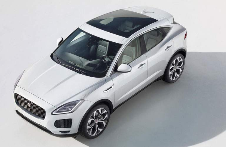 overhead view of a white 2018 Jaguar E-PACE on a white background