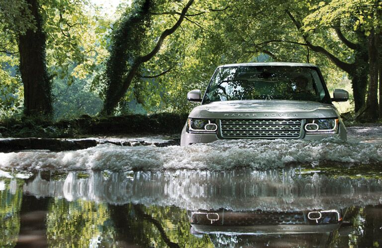 2016 Land Rover Range Rover driving through water
