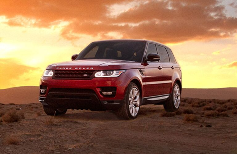 red 2016 Land Rover Range Rover Sport in front of the sunset