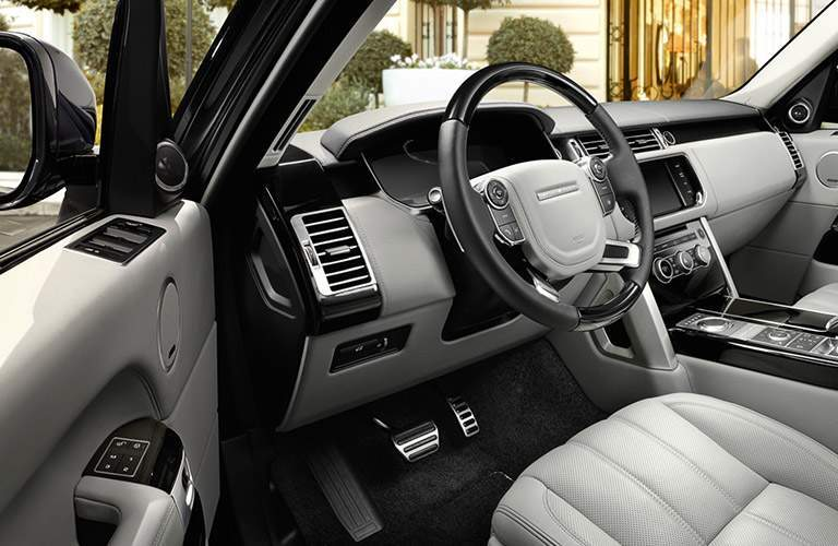 driver cockpit of the 2017 Land Rover Range Rover seen from the open side door