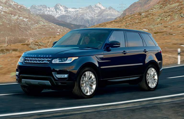 black 2017 Land Rover Range Rover with mountains in the background
