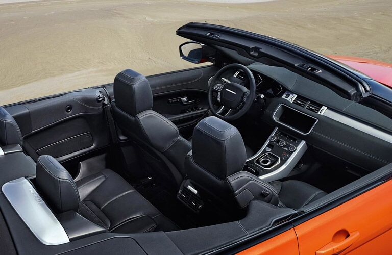 orange 2017 Land Rover Range Rover Evoque convertible with the top down
