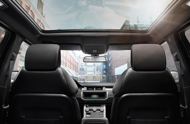view of the front seats and sunroof of the 2017 Land Rover Range Rover Evoque from behind