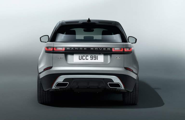 rear view of a silver 2018 Land Rover Range Rover Velar with a grey background