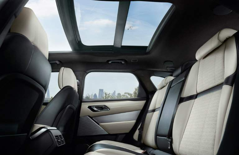 rear seats of the 2018 Land Rover Range Rover Velar with a nice view of the sunroof