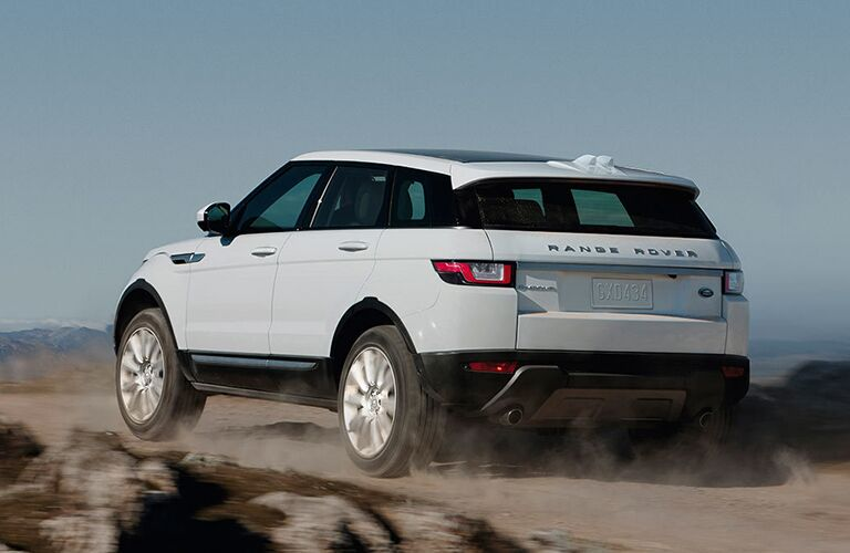 white 2018 Land Rover Range Rover Evoque driving on rocks