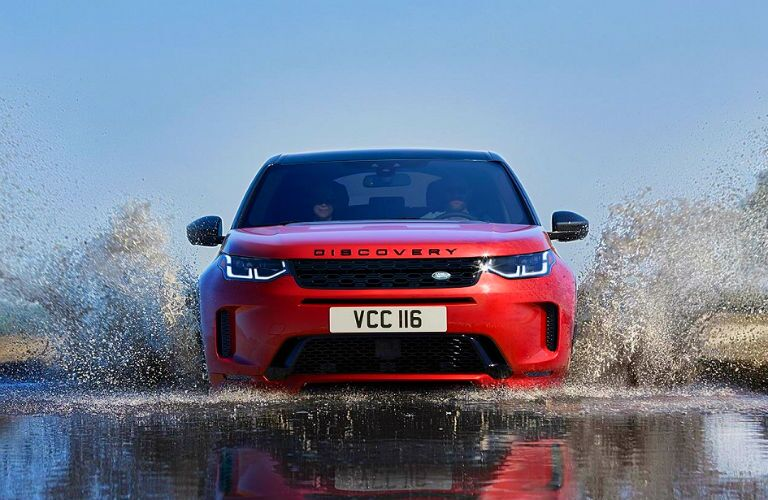 front of 2020 land rover discovery sport fording a river