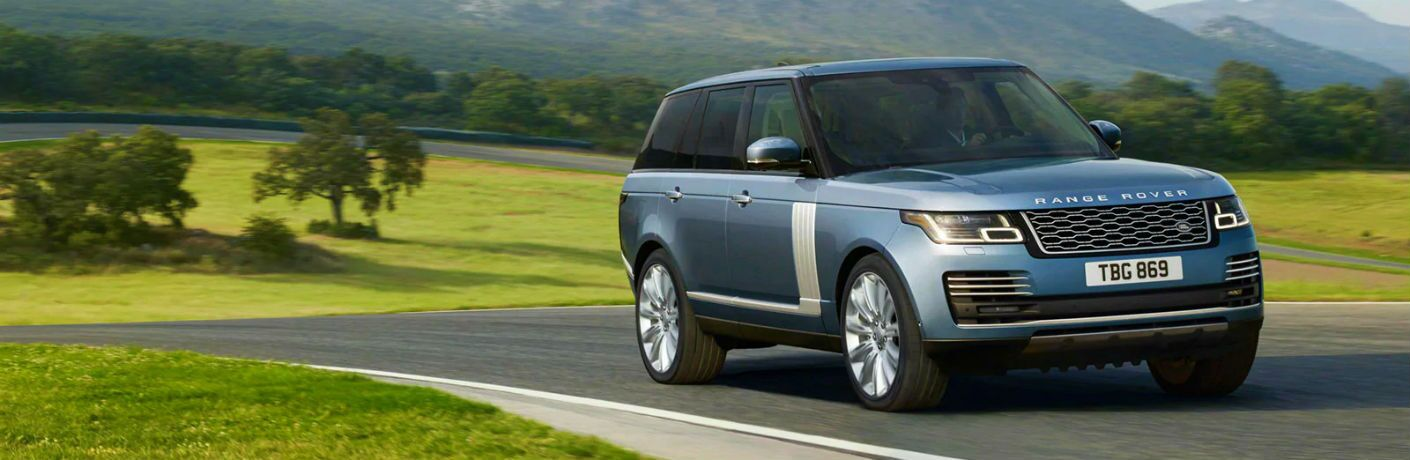 2020 range rover against rolling hill background in Kansas City