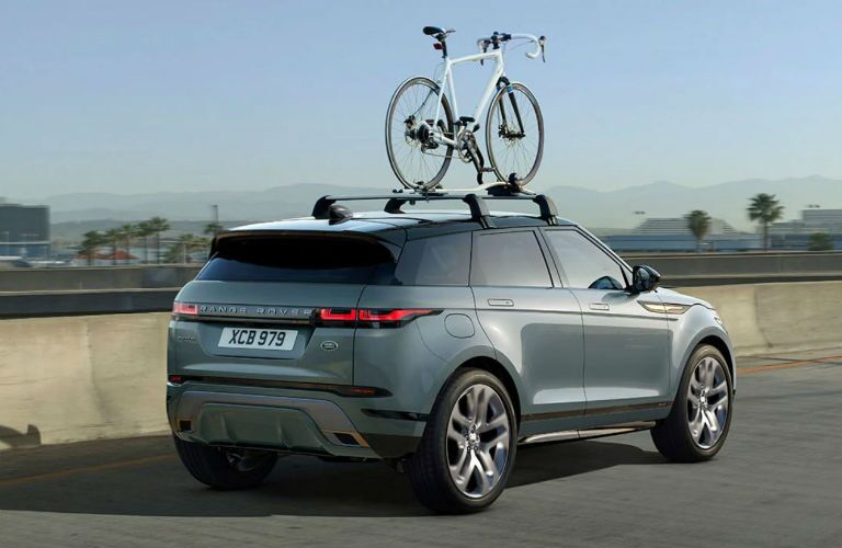 rear three-quarter view of 2020 range rover evoque with bike on roof
