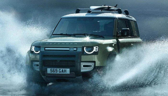Land Rover Defender driving through water