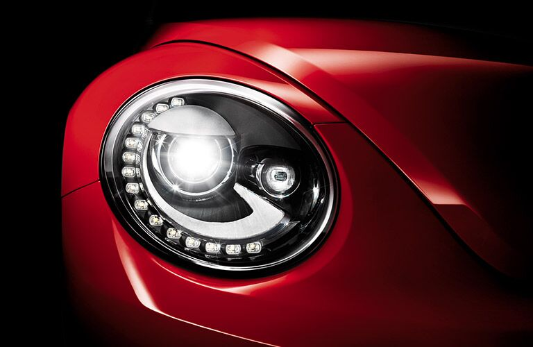 red 2016 VW Beetle headlight closeup