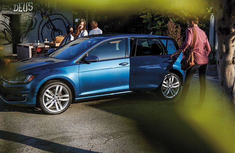 Blue 2016 Volkswagen Golf exterior from the side