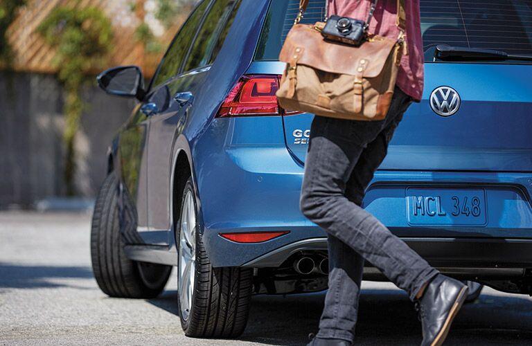 blue 2016 VW Golf hatchback rear door