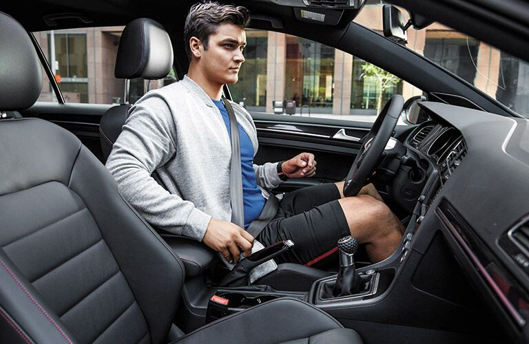 man buckling up in 2016 VW Golf GTI