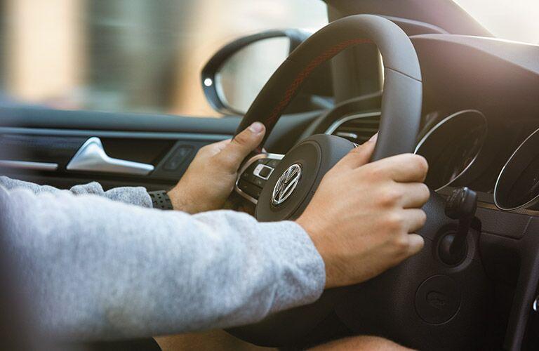 hands on steering wheel of 2016 VW Golf GTI