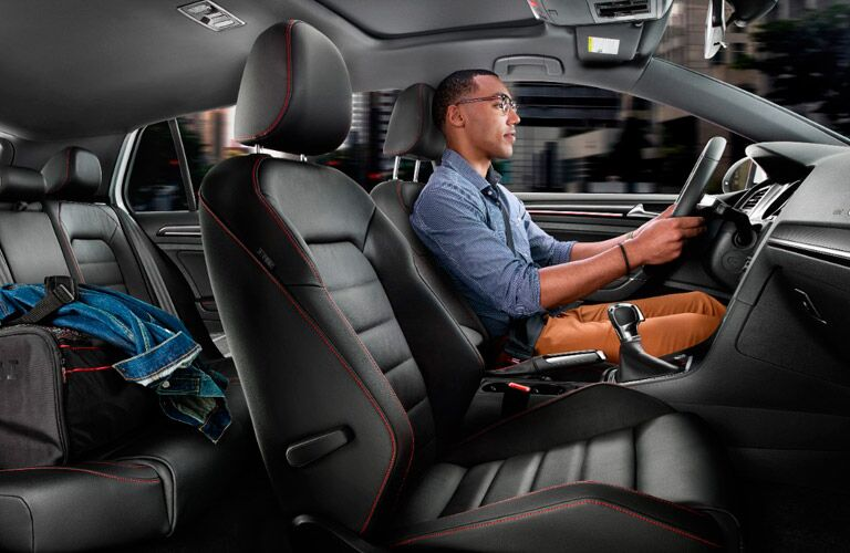 Black and Red 2017 Volkswagen Golf GTI interior with Man in driver's seat