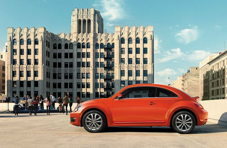 2016 VW Beetle with red exterior on a rooftop.
