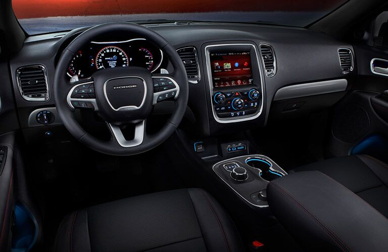 steering wheel and dashboard view of the 2016 Dodge Durango