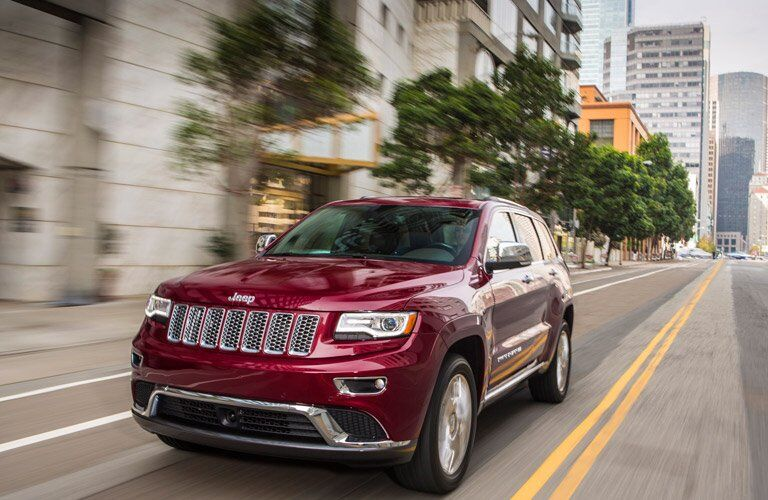 red 2016 Jeep Grand Cherokee in the city