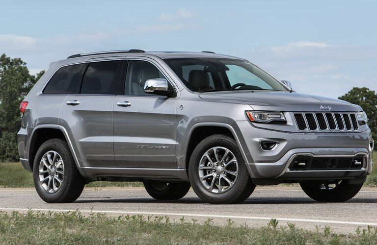 grey 2016 Jeep Grand Cherokee on the road