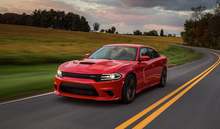 red 2016 Dodge Charger on a country road