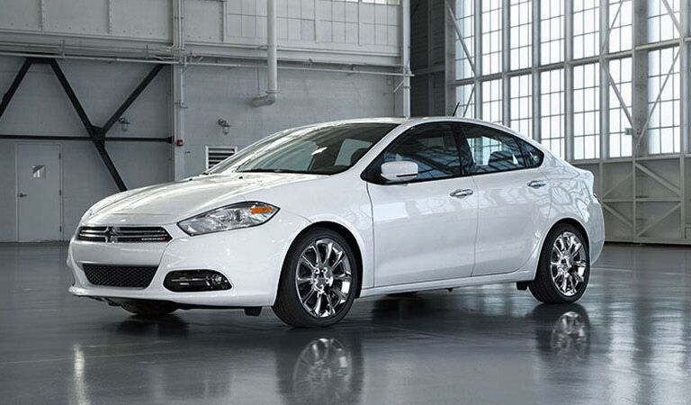 white Dodge Dart in a warehouse