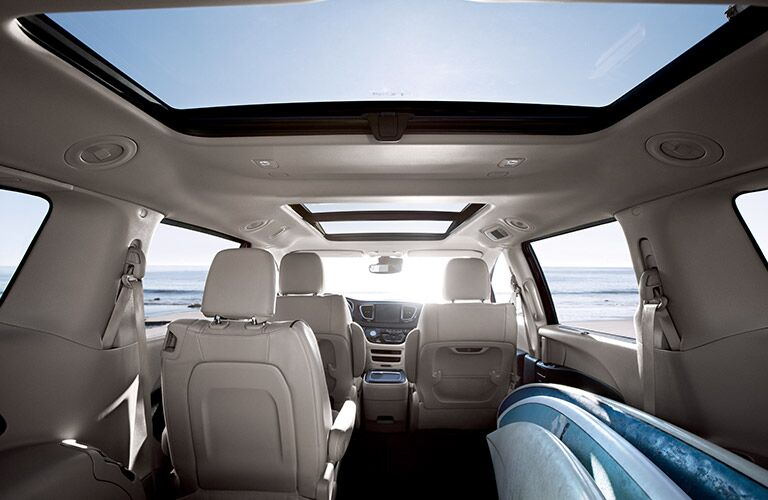 view of the interior of the 2017 Chrysler Pacifica (complete with surf board) as seen from the rear