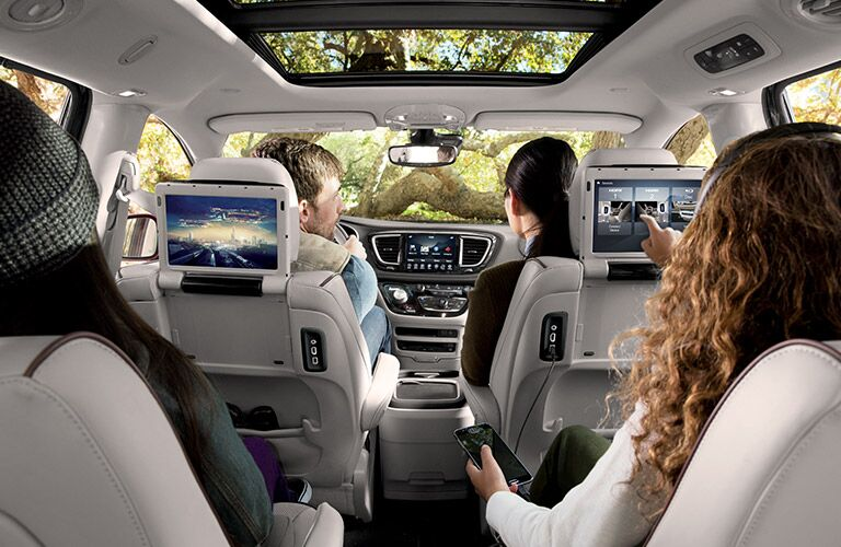 2017 Chrysler Pacifica cabin featuring children using rear entertainment system