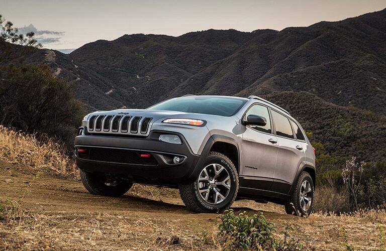 grey 2017 Jeep Cherokee in the wilderness
