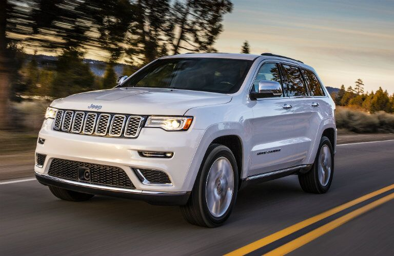 white 2017 Jeep Grand Cherokee on the road