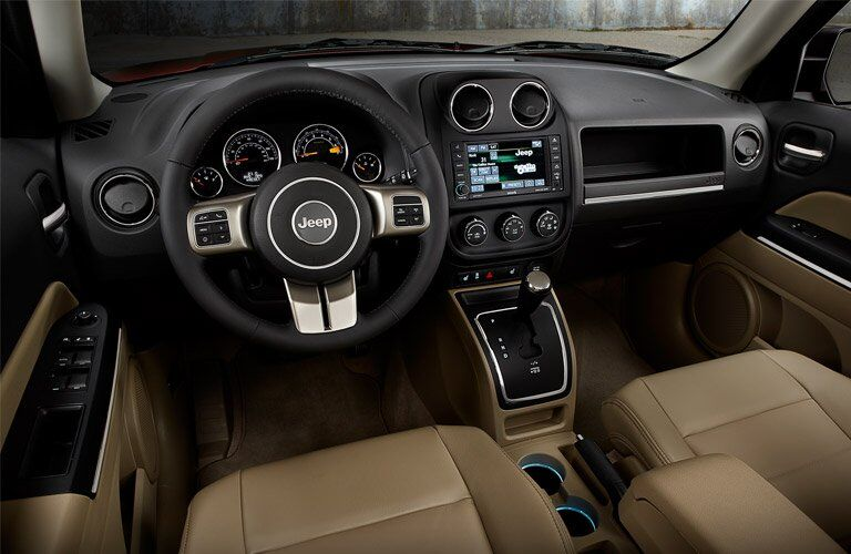 steering wheel and dashboard view of the 2017 Jeep Patriot