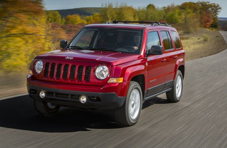 red 2017 Jeep Patriot on the back roads
