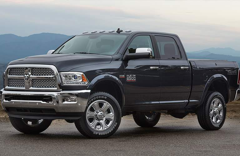 side view of a black 2017 Ram 2500 against a mountain backdrop