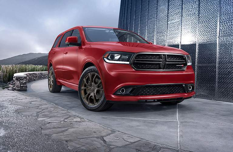side and front view of a red 2018 Dodge Durango