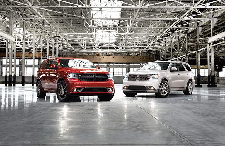 red and white models of the 2018 Dodge Durango in a warehouse