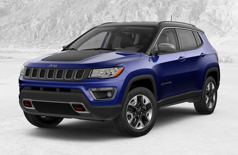 blue 2018 Jeep Compass trailhawk with a vague white-ish background