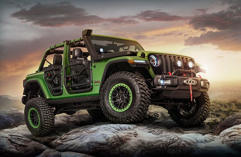 green 2018 Jeep Wrangler in the sunset